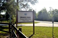 Sign for Orange Creek Conservation Area to hike or ride off County 318 near Citra in Marion County