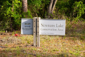 Sign for Newnan's Lake Conservation Area Hiking