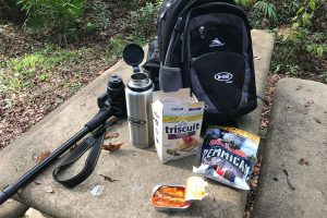Stone Picnic Table with Lunch and Hiking Gear