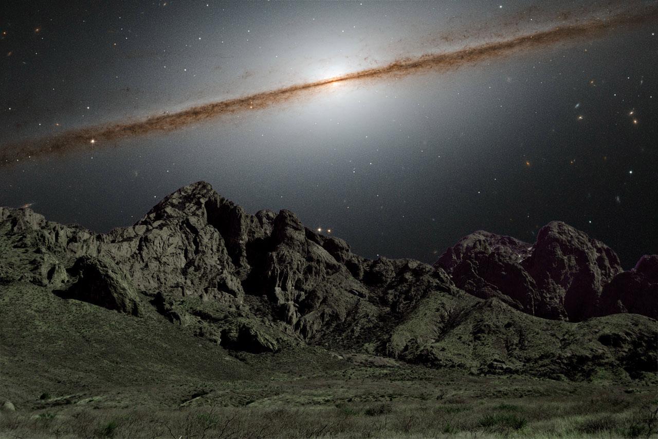 NASA composite of galaxy over mountains
