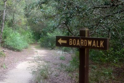 Sign pointing to the boardwalk